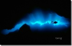 Diver in a grotto off of Roatan Island, Honduras
