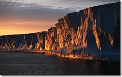 Adelie Sea, cliffs in sunset, Antarctica
