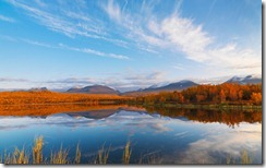 Clouds and Autumn Colors Reflected in Lake, Abisko National Park, Sweden