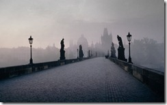 Charles Bridge crossing the Vltava river in Prague, Czech Republic