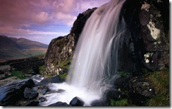 Waterfall and jagged rocks in Conor Pass, County Kerry, Ireland