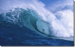 Professional surfer Garrett McNamara shooting the curl of Jaws, Peahi Bay, north shore of Maui, Hawaii