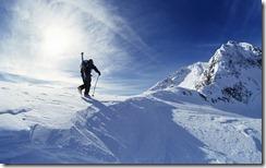Skier hiking to summit