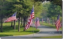 Flags line the entrance of the Massachusetts National Cemetery in Bourne, Cape Cod, Massachusetts