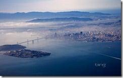 Aerial view of Yerba Buena and Treasure islands, Oakland Bay Bridge, and San Francisco, California .