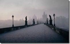 Charles Bridge crossing the Vltava river in Prague, Czech Republic