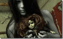 Ghostly dead girl with creepy doll