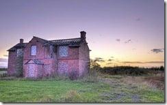 Abandoned house at sunset