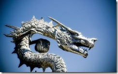Chinese dragon statue against a blue sky, Spain