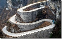 A bus descends the serpentine turns of  Tongtian Avenue on Tianmen Mountain near Zhangjiajie, Hunan Province, China